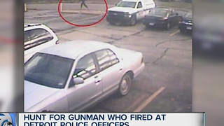 Search for man who fired at police officers - Video