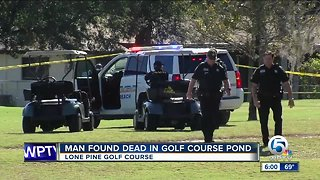 Officials pull a body from a lake at Riviera Beach golf course