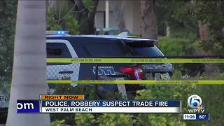 West Palm Beach officer, robbery suspect exchange gunfire - Video