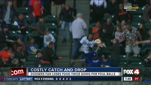 Fan drops food TWICE to catch foul balls at baseball game