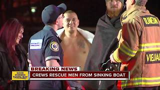 Crews rescue men from sinking boat off Honeymoon Island - Video