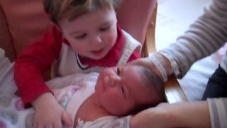 Little Boy Greets His New Baby Sister Home - Video