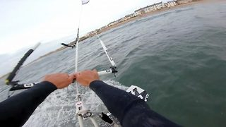 Kiteboarder flying high – Performing amazing flips high above the waves