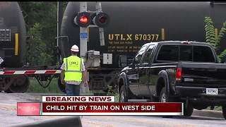 Child struck by train on Indy's west side, listed in critical condition - Video