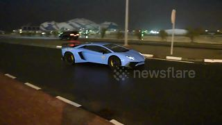 Lamborghini driver does donut in puddle - Video