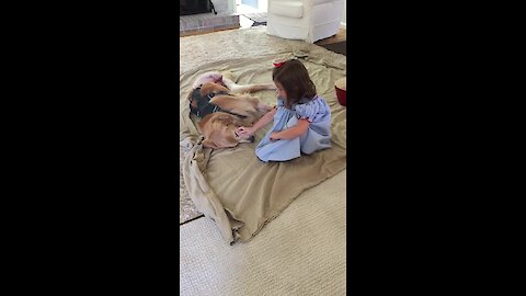 Little Girl Preciously Comforts Dog After Surgery