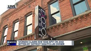 Woman claims she was spit on and bitten by Detroit nightclub owner - Video