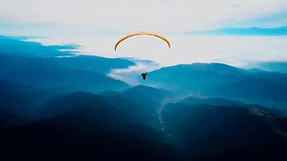 Drone flight captures paragliding above majestic Wild Carpathia