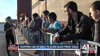 Shoppers in line early to score Black Friday deals - Video