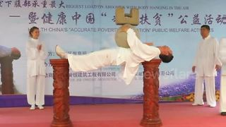 Tai chi master creates world record for carrying heaviest load on gut - Video