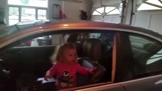 """""""Toddler Girl Absolutely Amazed by Garage Door Closing"""""""