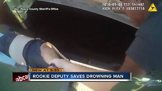 Rookie deputy saves drowning man - Video