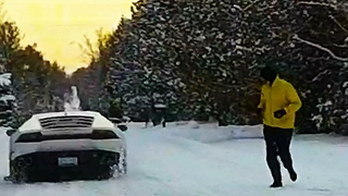 Jogger shocked after spotting Lamborghini on road following snow storm - Video