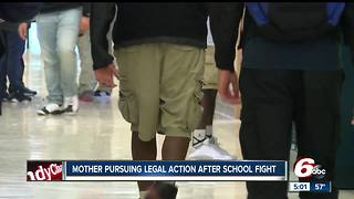 Mother taking daughter out of school, pursuing legal action after a fight on school grounds - Video
