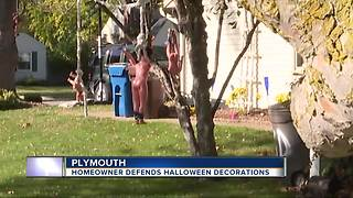 Homeowner defends creepy Halloween decorations - Video