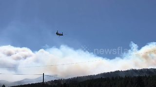 Helicopter races toward smoke-filled forest to battle massive New Mexico fire - Video