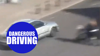 Boy racer almost mowing down mum and baby while speeding through town centre