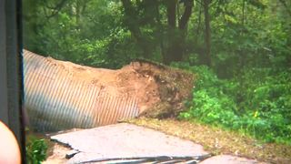 Road washed away by floods in Washington County