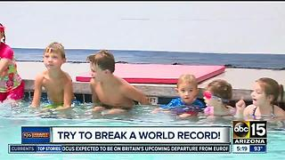 Aqua-Tots offering free class, going for 'World's Largest Swimming Lesson' record! - Video
