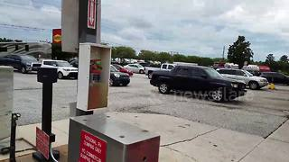 Cars line up at Florida petrol station before Hurricane Irma hits