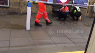 Police investigate stabbing scene at Leytonstone station - Video