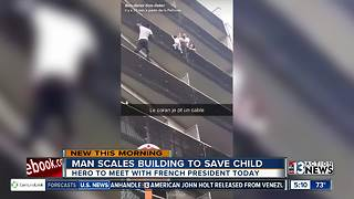 Man saves child dangling from balcony - Video