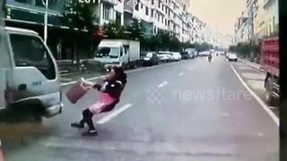 Woman Slips While Crossing The Street And Narrowly Escapes An Incoming Truck - Video