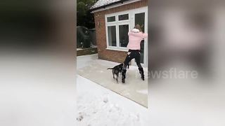 Woman Slips On Ice Trying To Open Back Door - Video