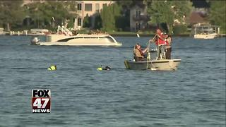 Divers recover teen's body from Oakland County's Cass Lake - Video