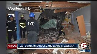 Car crashes into Speedway, Indiana house, ends up in basement after fleeing from police - Video
