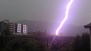 Intense close range footage of lightning striking bridge - Video