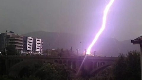 Man Whips His Camera Out Just As Bridge Gets Hit By Lightning