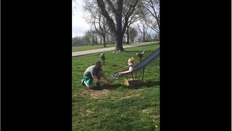 Dad fails at catching daughter off slide