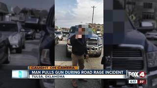 Man points gun during road rage incident - Video