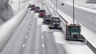 Snow fighters use synchronized snow plowing technique to clear highway