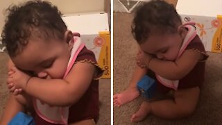 Tired toddler falls asleep in adorably funny position