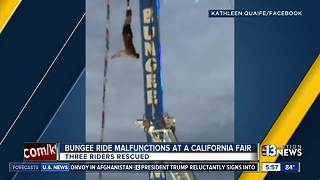 Man stuck on bungee ride in California - Video
