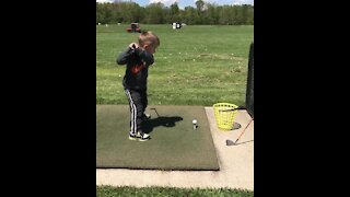 Little boy's golf swing ends in hilarious epic fail