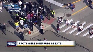 Protesters demonstrate during Detroit debate