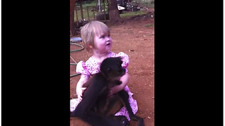 Pet monkey adorably cuddles with little girl - Video