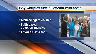 Gay couples settle lawsuit with Michigan
