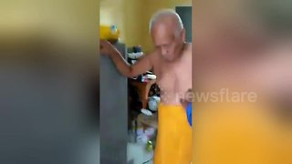 Elderly Buddhist monk caught romping with woman - Video
