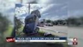 Truck lands on front wheels, utility wire - Video