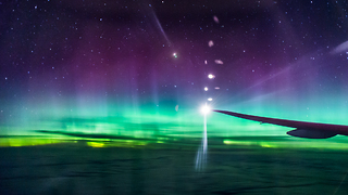 Amazing View of Northern Lights Captured In-Flight - Video