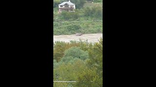 Boat dock floats down river during historic flood in Marble Falls, Texas - Video