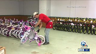 Firefighters and paramedics assemble bikes for kids in Martin County