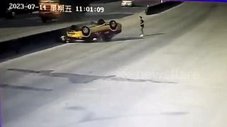 Man jumps off motorcycle to escape being crushed by learner driver - Video