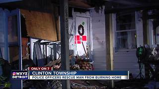 Clinton Township police wake sleeping man, rescue him from burning house - Video