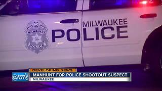 Manhunt for police shootout suspect - Video