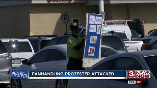 Panhandling protester attacked again